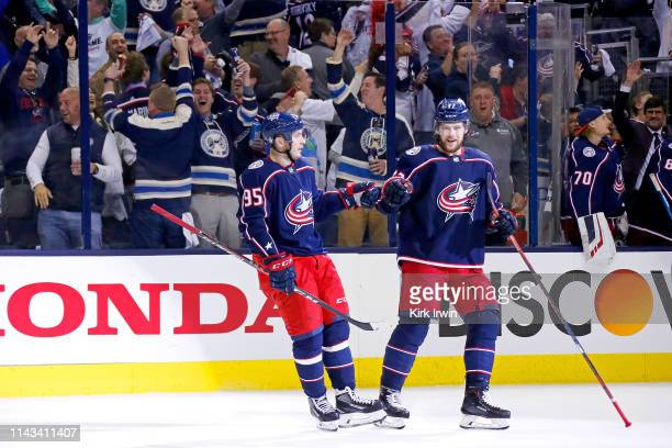 Matt Duchene of the Columbus Blue Jackets and Josh Anderson celebrate at the end of Game Four of the Eastern Conference First Round during the 2019...