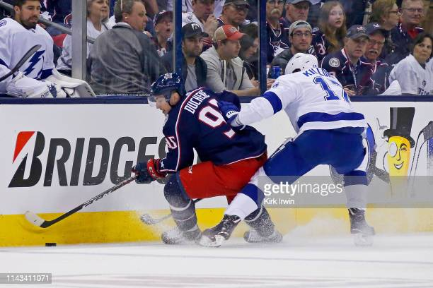 Matt Duchene of the Columbus Blue Jackets attempts to skate the puck away from Alex Killorn of the Tampa Bay Lightning in Game Four of the Eastern...