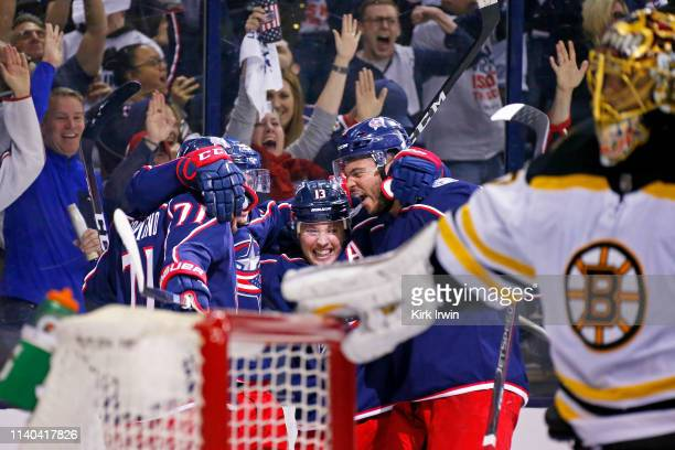 Matt Duchene of the Columbus Blue Jackets is congratulated by his teammates after beating Tuukka Rask of the Boston Bruins for a goal during the...