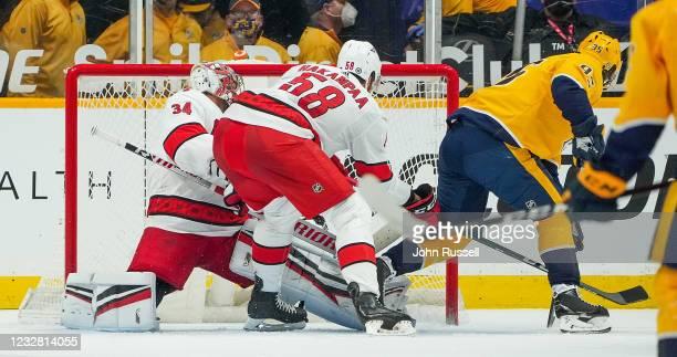 Matt Duchene of the Nashville Predators beats goalie Petr Mrazek of the Carolina Hurricanes for a goal as Jani Hakanpaa defends during the first...