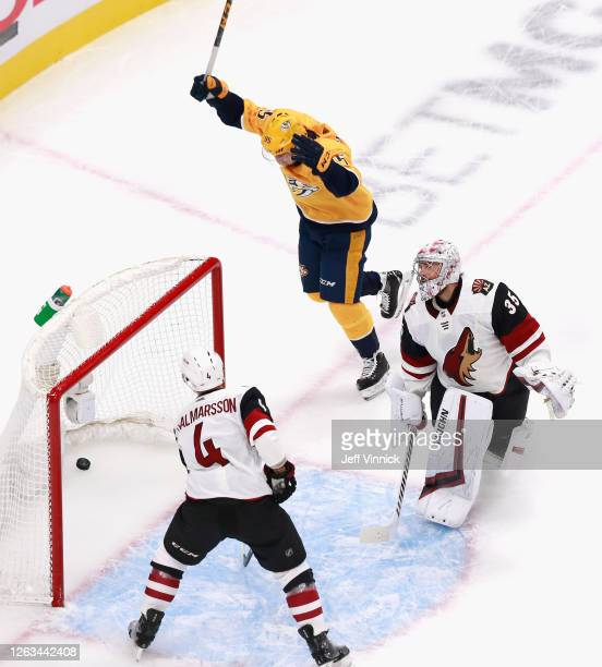 Matt Duchene of the Nashville Predators celebrates a first period power-play goal by Filip Forsberg against Darcy Kuemper of the Arizona Coyotes in...