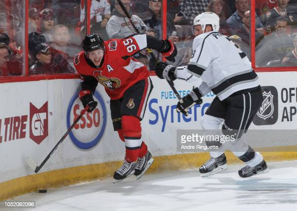 Matt Duchene of the Ottawa Senators battles for puck possession along the corner boards against Dion Phaneuf of the Los Angeles Kings at Canadian...