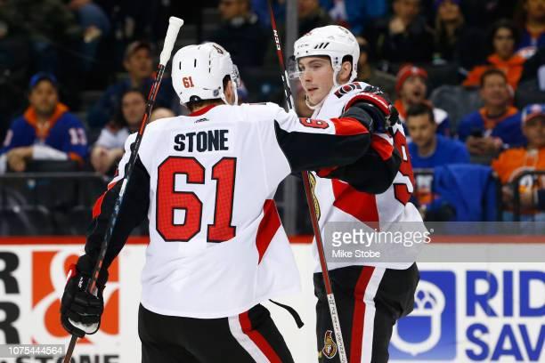 Matt Duchene of the Ottawa Senators celebrates a second period goal with Mark Stone against the New York Islanders at Barclays Center on December 28...