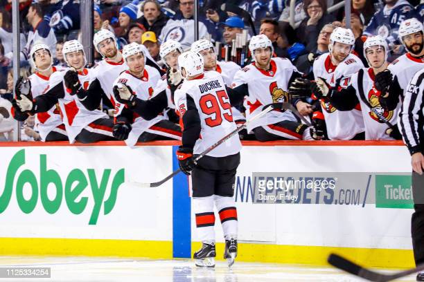 Matt Duchene of the Ottawa Senators celebrates his third period goal against the Winnipeg Jets with teammates at the bench at the Bell MTS Place on...