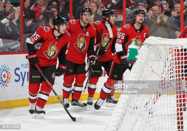 Matt Duchene of the Ottawa Senators celebrates his third period powerplay goal against the New York Islanders with teammates Mark Stone Mike Hoffman...
