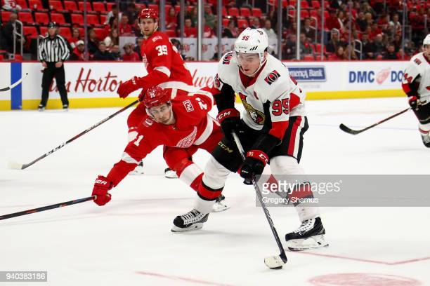 Matt Duchene of the Ottawa Senators looks for a shot in front of Dylan Larkin of the Detroit Red Wings during the third period at Little Caesars...