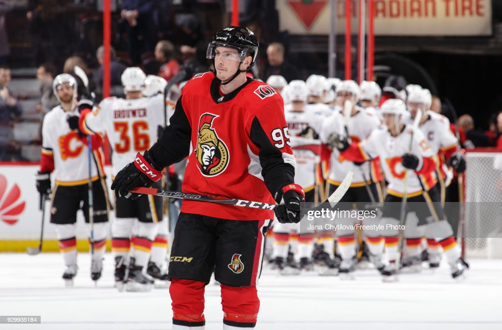 Matt Duchene #95 of the Ottawa Senators reacts as members of the Calgary Flames celebrate their win at the Canadian Tire Centre on March 9, 2018 in Ottawa, Ontario, Canada.
