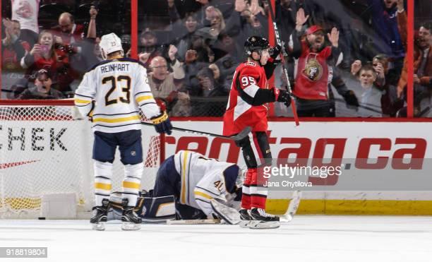 Matt Duchene of the Ottawa Senators reacts to the overtime goal scored by team mate Mike Hoffman as Robin Lehner and Sam Reinhart of the Buffalo...