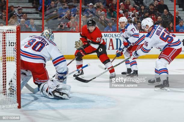 Matt Duchene of the Ottawa Senators shoots the puck against Henrik Lundqvist of the New York Rangers as Tony DeAngelo and Nick Holden defend at...
