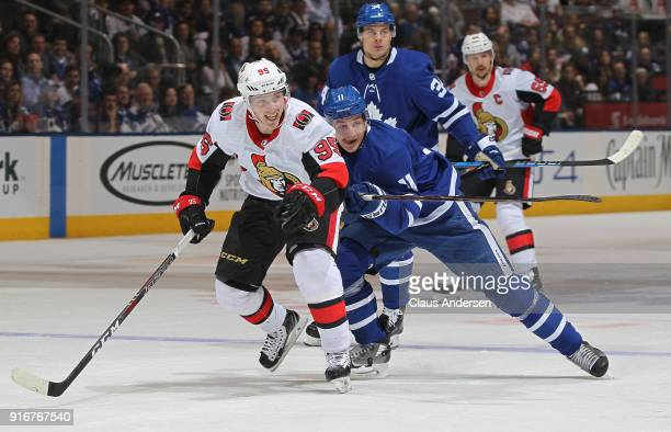 Matt Duchene of the Ottawa Senators skates away from a checking Zach Hyman of the Toronto Maple Leafs during an NHL game at the Air Canada Centre on...