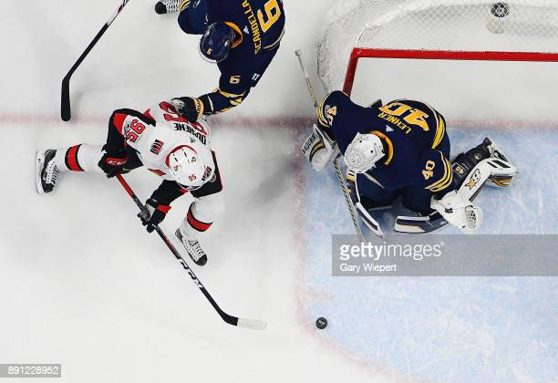 Matt Duchene of the Ottawa Senators skates from behind the net with the puck against Robin Lehner of the Buffalo Sabres during an NHL game on...