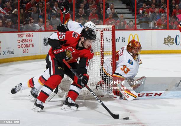 Matt Duchene of the Ottawa Senators skates with the puck behind the net on a wraparound attempt against David Rittich of the Calgary Flames at...