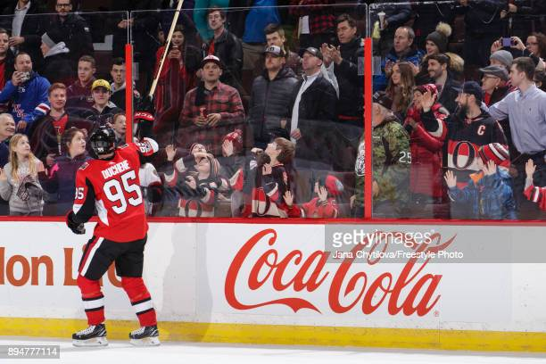 Matt Duchene of the Ottawa Senators tosses his stick over the glass to a fan after being named the second start of the game against the New York...
