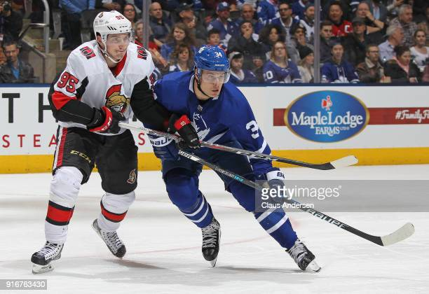 Matt Duchene of the Ottawa Senators tries to hold up Auston Matthews of the Toronto Maple Leafs during an NHL game at the Air Canada Centre on...