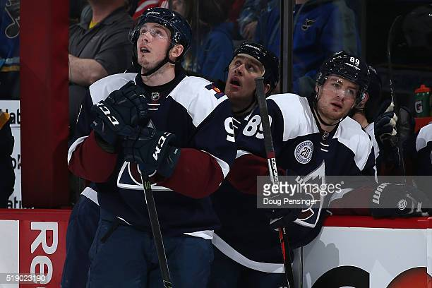 Matt Duchene Shawn Matthias and Mikkel Boedker of the Colorado Avalanche look on as the St Louis Blues celebrate a goal by Colton Parayko of the St...