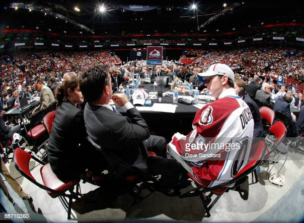 Matt Duchene sits with the Colorado Avalanche organization members at their table after being selected third overall by the Avalanche with their...