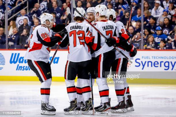 Matt Duchene Thomas Chabot Mark Stone Brady Tkachuk and Bobby Ryan of the Ottawa Senators celebrate a third period goal against the Winnipeg Jets at...