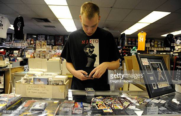 Matt Duerksen an employee for the past two years at Bill's Sports Collectibles store in Denver organizes baseball cards on Friday afternoon May 28...