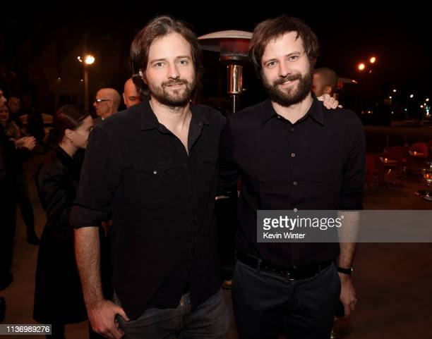 Matt Duffer and Ross Duffer pose at the after party for the premiere of Netflix's The OA Part II at LACMA on March 19 2019 in Los Angeles California