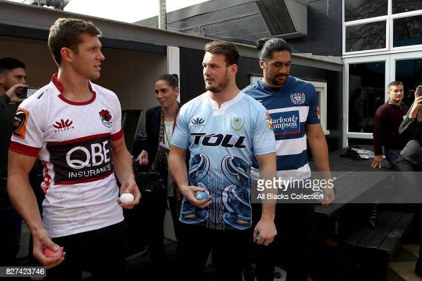 Matt Duffie Matt Moulds and Michael Fatialofa throw paint bombs at a map of New Zealand during the Mitre 10 Cup Season Launch at the College Rifles...