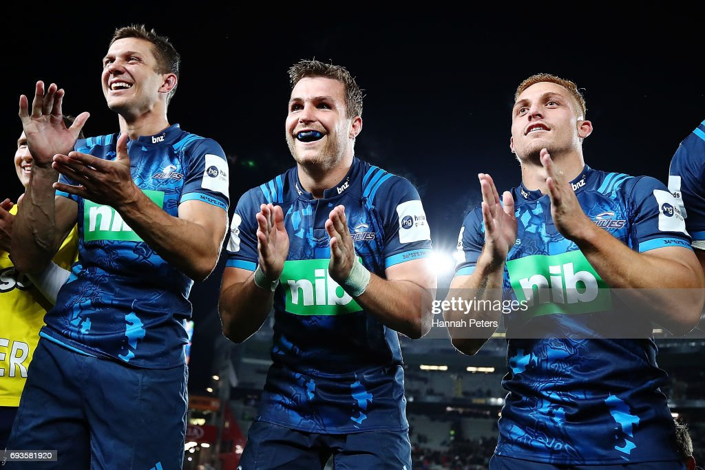 Matt Duffie, Michael Collins, Ihaia West,and Jimmy Tupou celebrate after winning the match between the Auckland Blues and the British & Irish Lions at Eden Park on June 7, 2017 in Auckland, New Zealand.