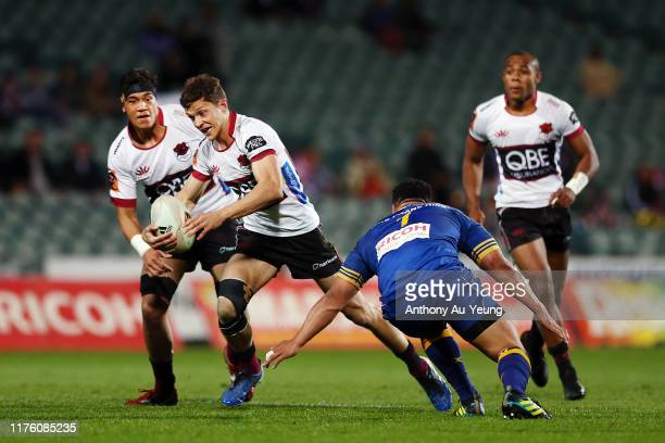 Matt Duffie of North Harbour makes a run against Aki Seiuli of Otago during the round 7 Mitre 10 Cup match between North Harbour and Otago at QBE...