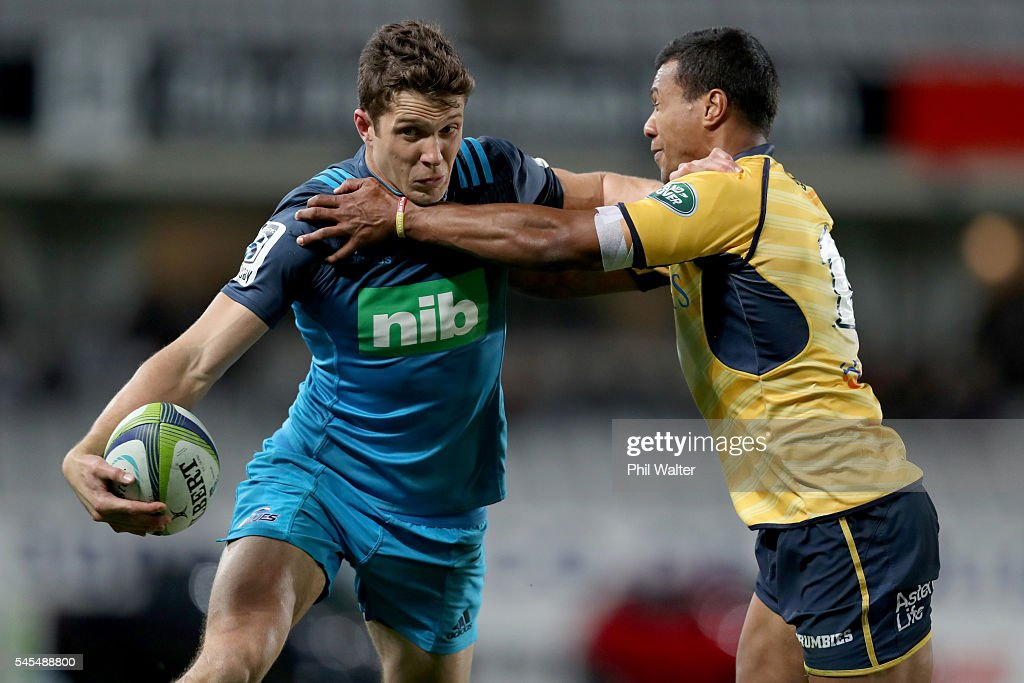 Matt Duffie of the Blues (L) is tackled by Aidan Toua of the Brumbies (R) during the round 16 Super Rugby match between the Blues and the Brumbies at Eden Park on July 8, 2016 in Auckland, New Zealand.