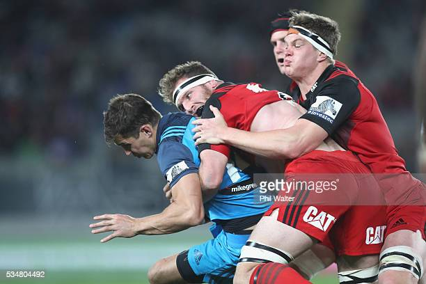 Matt Duffie of the Blues is tackled by Kieran Read of the Crusaders during the round 14 Super Rugby match between the Blues and the Crusaders at Eden...