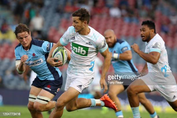 Matt Duffie of the Blues is tackled by Michael Hooper of the Waratahs during the round 2 Super Rugby match between the Waratahs and the Blues at...
