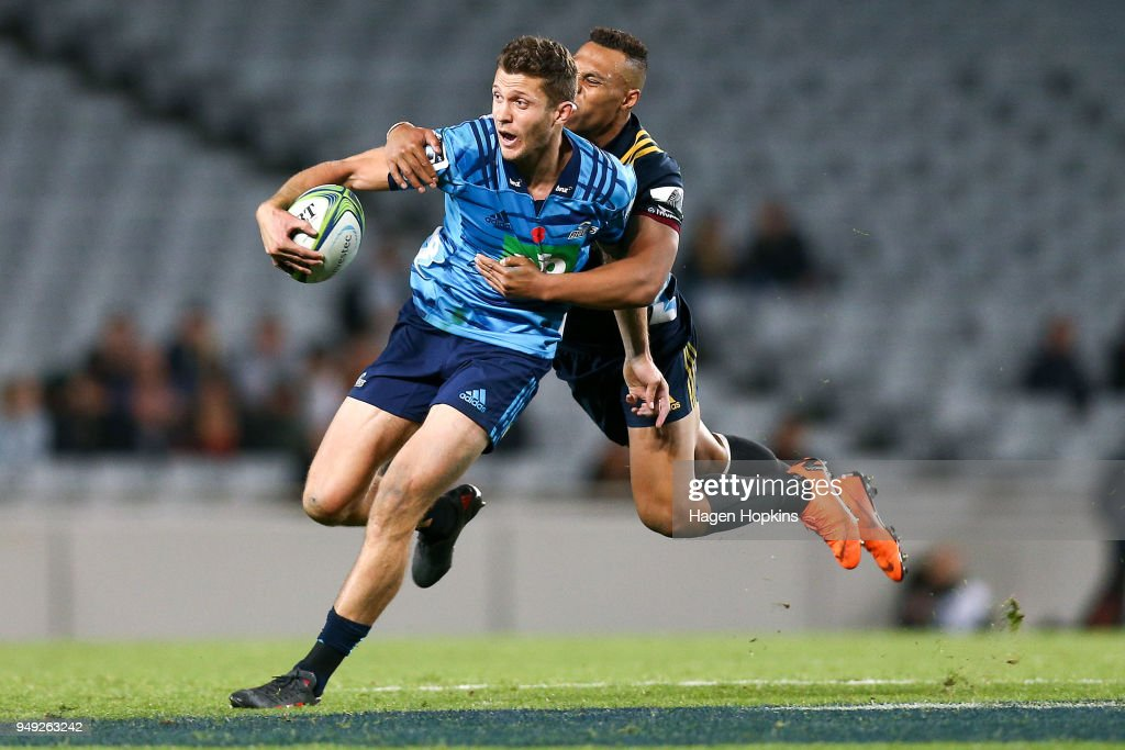 Matt Duffie of the Blues is tackled by Tevita Li of the Highlanders during the round 10 Super Rugby match between the Blues and the Highlanders at Eden Park on April 20, 2018 in Auckland, New Zealand.
