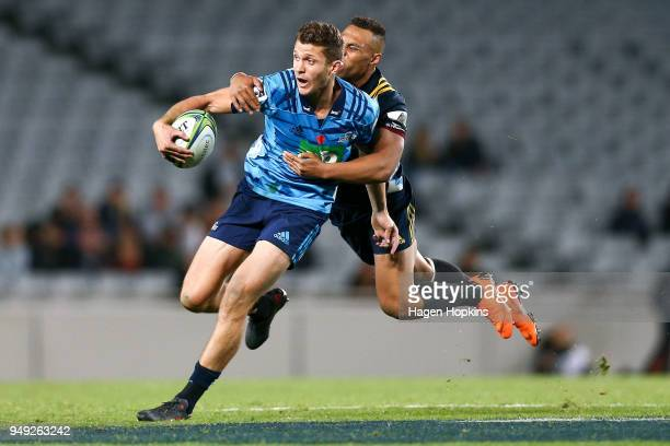 Matt Duffie of the Blues is tackled by Tevita Li of the Highlanders during the round 10 Super Rugby match between the Blues and the Highlanders at...
