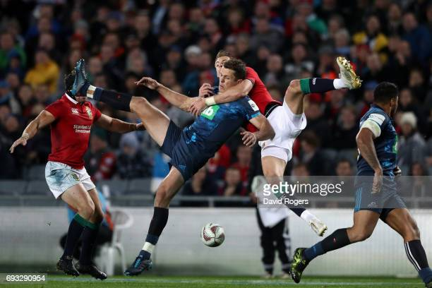 Matt Duffie of the Blues is tackled in the air by Liam Williams of the British Irish Lions during the 2017 British Irish Lions tour match between the...