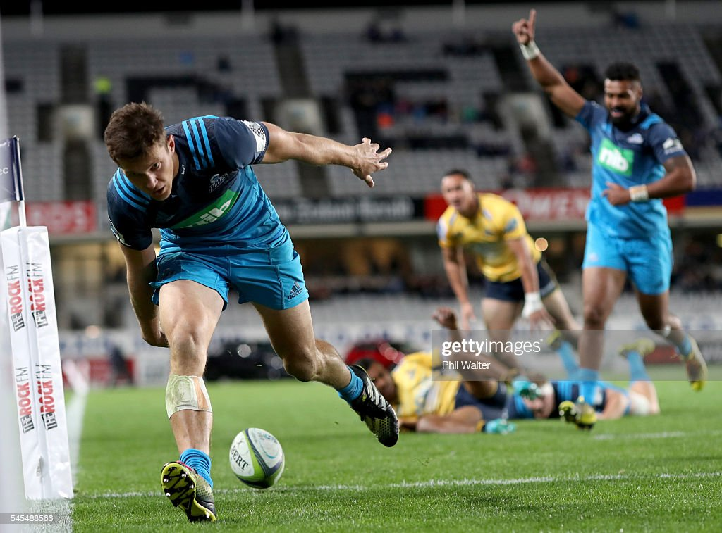 Matt Duffie of the Blues scores a try during the round 16 Super Rugby match between the Blues and the Brumbies at Eden Park on July 8, 2016 in Auckland, New Zealand.