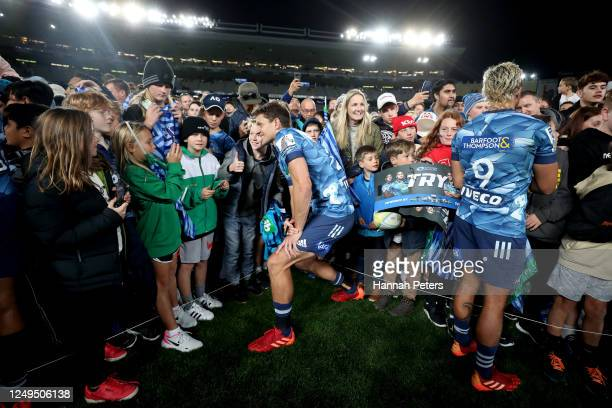 Matt Duffie of the Blues signs autographs after the round 1 Super Rugby Aotearoa match between the Blues and the Hurricanes at Eden Park on June 14,...