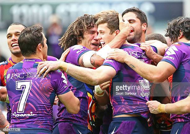 Matt Duffie of the Melbourne Storm is congratulated by his teammates after scoring a try during the round 22 NRL match between the Melbourne Storm...