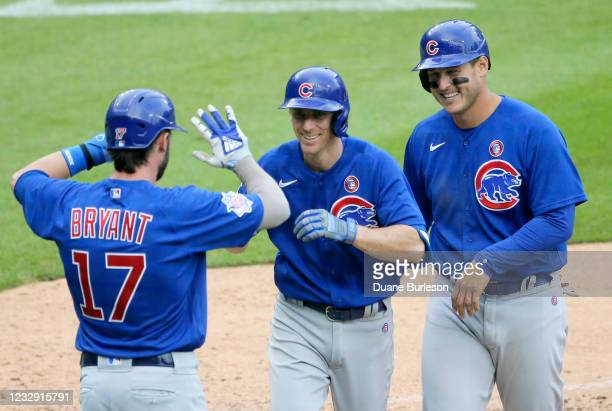 Matt Duffy of the Chicago Cubs celebrates with Kris Bryant and Anthony Rizzo after hitting a three-run home run during the fifth inning to take a 7-6...