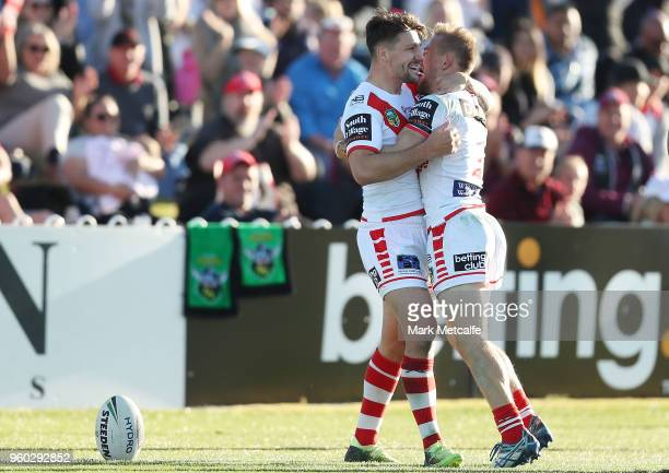 Matt Duffy of the Dragons celebrates scoring a try with team mate Gareth Widdop of the Dragons during the round 11 NRL match between the St George...