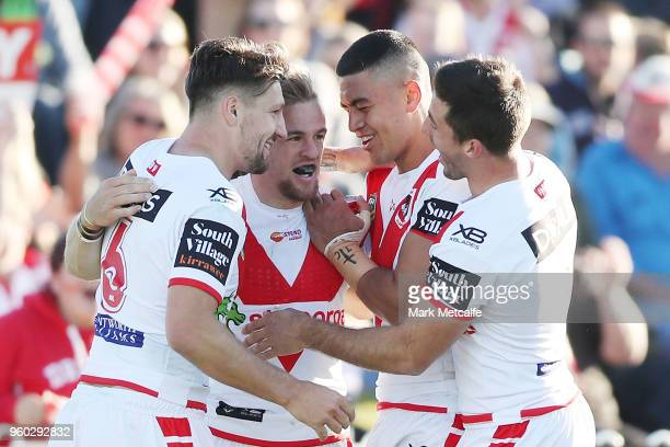 Matt Duffy of the Dragons celebrates scoring a try with team mates during the round 11 NRL match between the St George Illawarra Dragons and the...