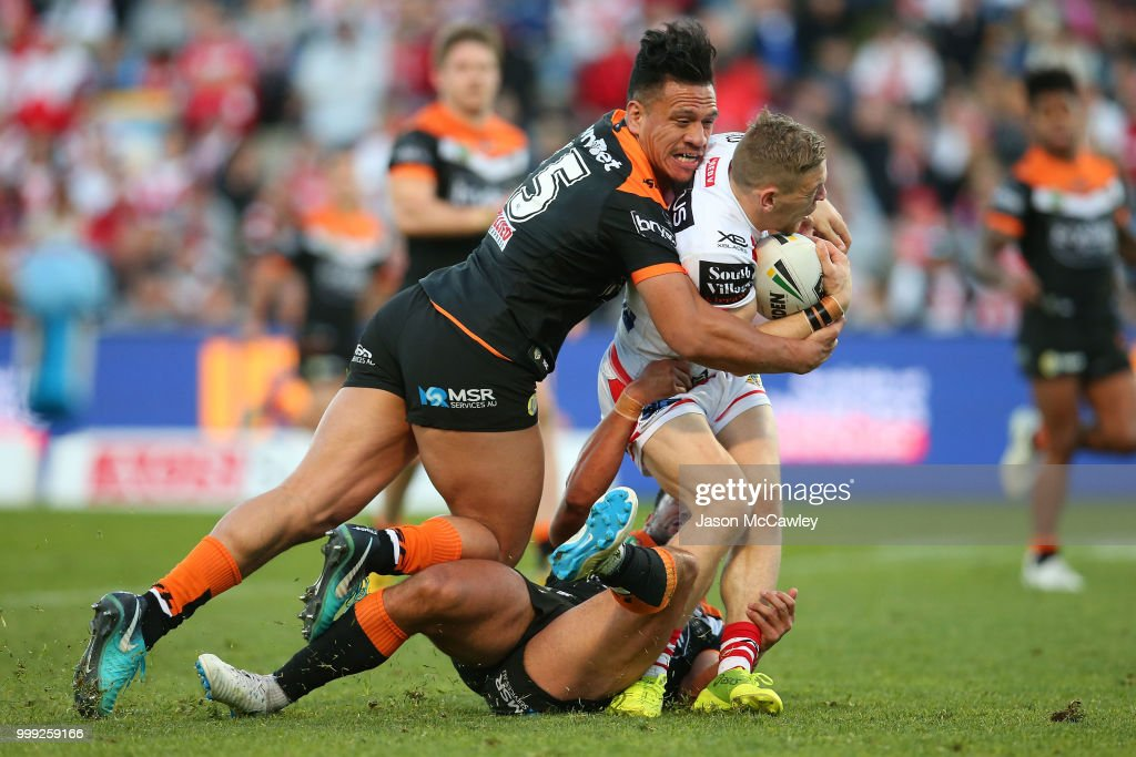 Matt Duffy of the Dragons is tackled by Sauaso Sue of the Tigers during the round 18 NRL match between the St George Illawarra Dragons and the Wests Tigers at UOW Jubilee Oval on July 15, 2018 in Sydney, Australia.