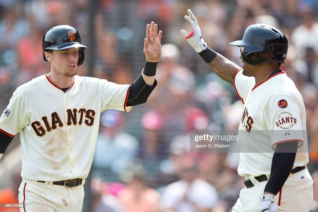 Matt Duffy #5 of the San Francisco Giants is congratulated by Marlon Byrd #6 after scoring a run against the San Diego Padres during the fifth inning at AT&T Park on September 13, 2015 in San Francisco, California. The San Francisco Giants defeated the San Diego Padres 10-3.
