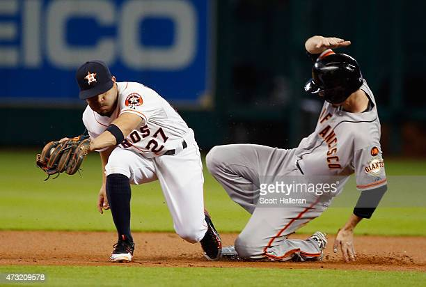 Matt Duffy of the San Francisco Giants steals second base under the tag of Jose Altuve of the Houston Astros in the first inning of their game at...