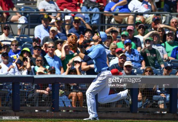 Matt Duffy of the Tampa Bay Rays attempts the catch in the fourth inning during the spring training game between the Tampa Bay Rays and the Boston...