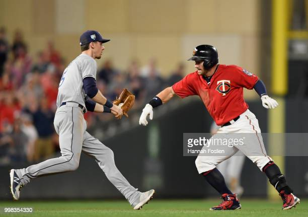Matt Duffy of the Tampa Bay Rays catches Robbie Grossman of the Minnesota Twins off second base after an RBI double during the sixth inning of the...
