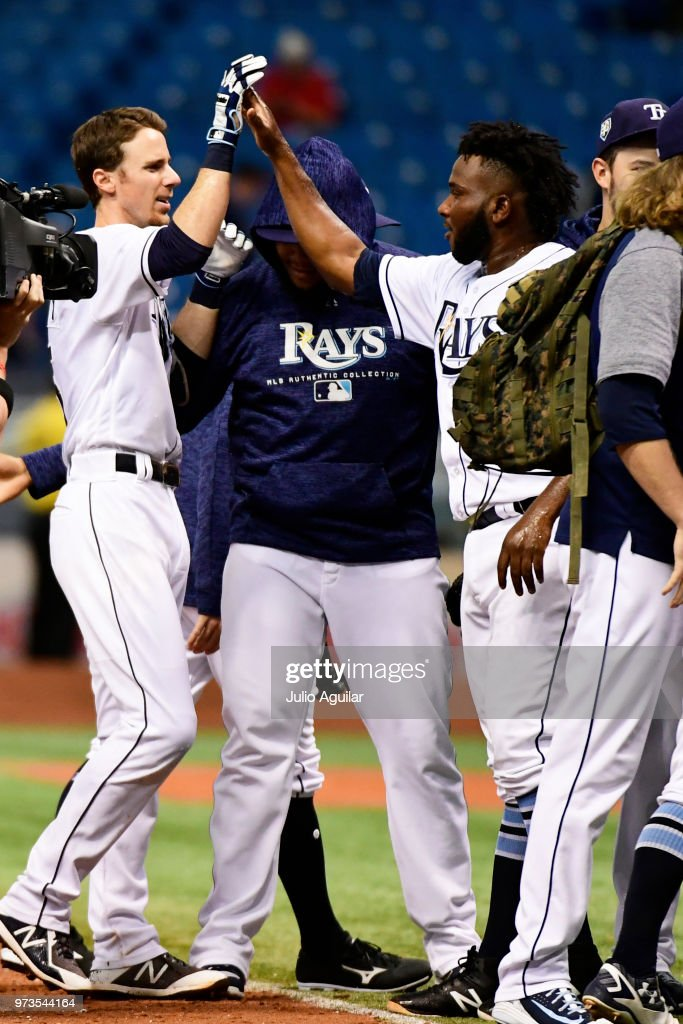 Matt Duffy #5 of the Tampa Bay Rays celebrates with teammates after hitting a walk-off single against the Toronto Blue Jays on June 13, 2018 at Tropicana Field in St Petersburg, Florida. The Rays won 1-0.