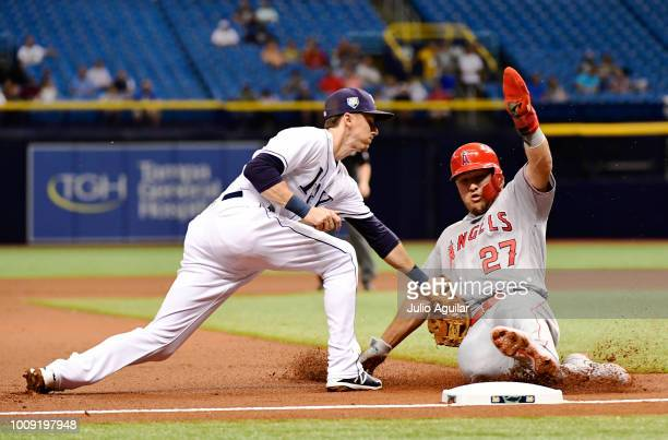 Matt Duffy of the Tampa Bay Rays tags Mike Trout of the Los Angeles Angels out on an attempted steal on August 1 2018 at Tropicana Field in St...
