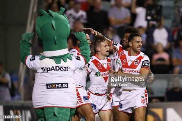 Matt Dufty of the Dragons celebrates with his team mates after scoring a try during the round 6 NRL match between the Dragons and the Sea Eagles at...
