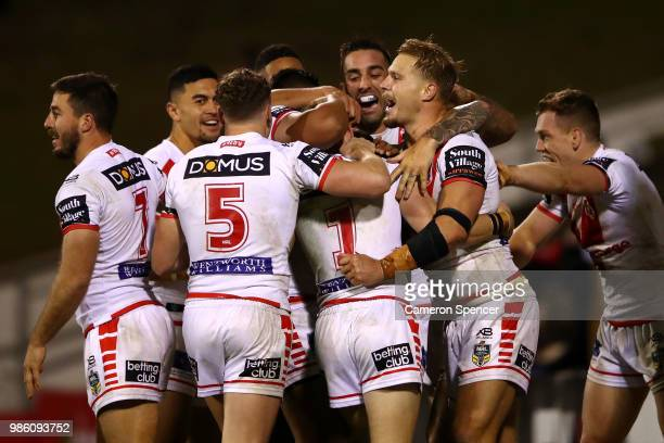 Matt Dufty of the Dragons celebrates with team mates after scoring the winning try during the round 16 NRL match between the St George Illawarra...