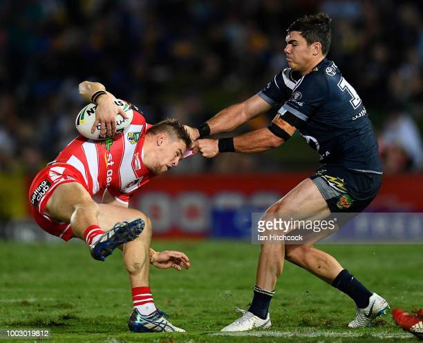 Matt Dufty of the Dragons runs the ball during the round 19 NRL match between the North Queensland Cowboys and the St George Illawarra Dragons at...