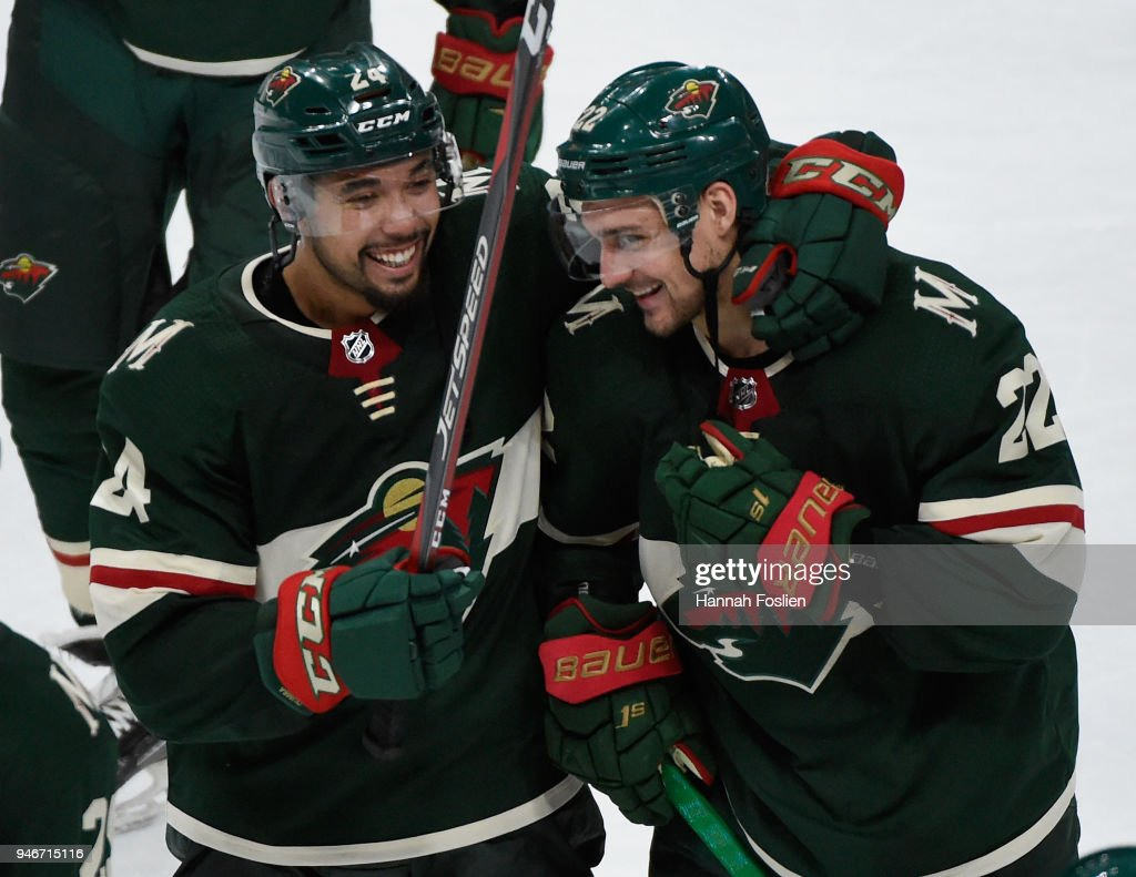 Matt Dumba #24 and Nino Niederreiter #22 of the Minnesota Wild celebrate a winning Game Three of the Western Conference First Round against the Winnipeg Jets during the 2018 NHL Stanley Cup Playoffs at Xcel Energy Center on April 15, 2018 in St Paul, Minnesota. The Wild defeated the Jets 6-2.