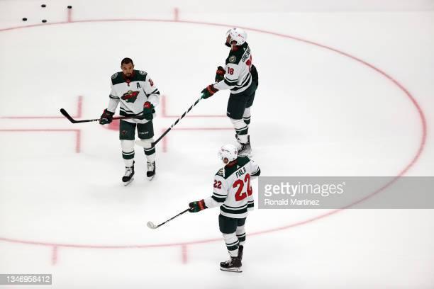 Matt Dumba, Jordan Greenway and Kevin Fiala of the Minnesota Wild at Honda Center on October 15, 2021 in Anaheim, California.